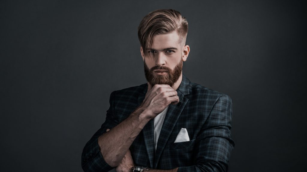 Slicked Back Men's Haircut with High Fade