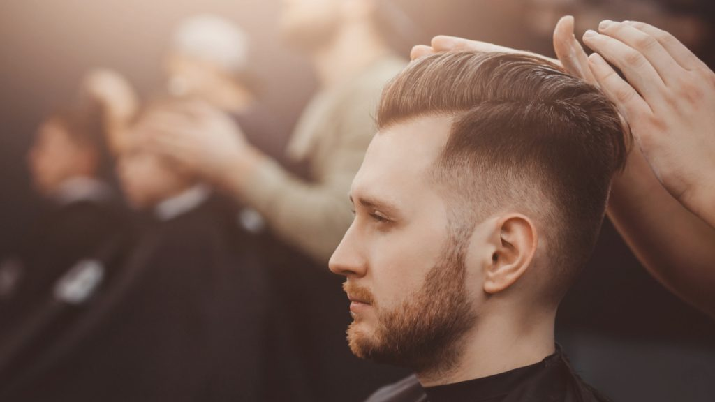 Slicked Back Men's Haircut with High Fade Hairstyles Men